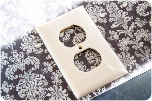 Scrapping switch plate cover